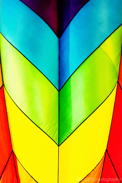 Abstract of hot air balloon with blue, green, yellow, and red