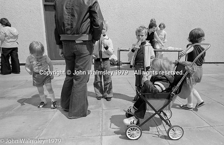 Festival & Gala Day at the Education Centre, Wester Hailes, Scotland, 1979.  John Walmsley was Photographer in Residence at the Education Centre for three weeks in 1979.  The Education Centre was, at the time, Scotland's largest purpose built community High School open all day every day for all ages from primary to adults.  The town of Wester Hailes, a few miles to the south west of Edinburgh, was built in the early 1970s mostly of blocks of flats and high rises.