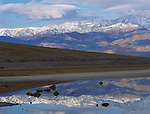 Death Valley National Park, CA<br /> Morning clouds over Panamint Mountains & reflection in still pool at Badwater