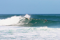 Pipeline Posse surfer, Flynn Novak does a cutback off the top of the wave at Pipeline on Oahu's North Shore.