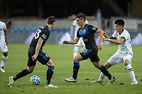 SAN JOSE, CA - SEPTEMBER 16: Cristian Espinoza #10 of the San Jose Earthquakes & Marco Farfan #32 of the Portland Timbers battle for the ball during a game between Portland Timbers and San Jose Earthquakes at Earthquakes Stadium on September 16, 2020 in San Jose, California.