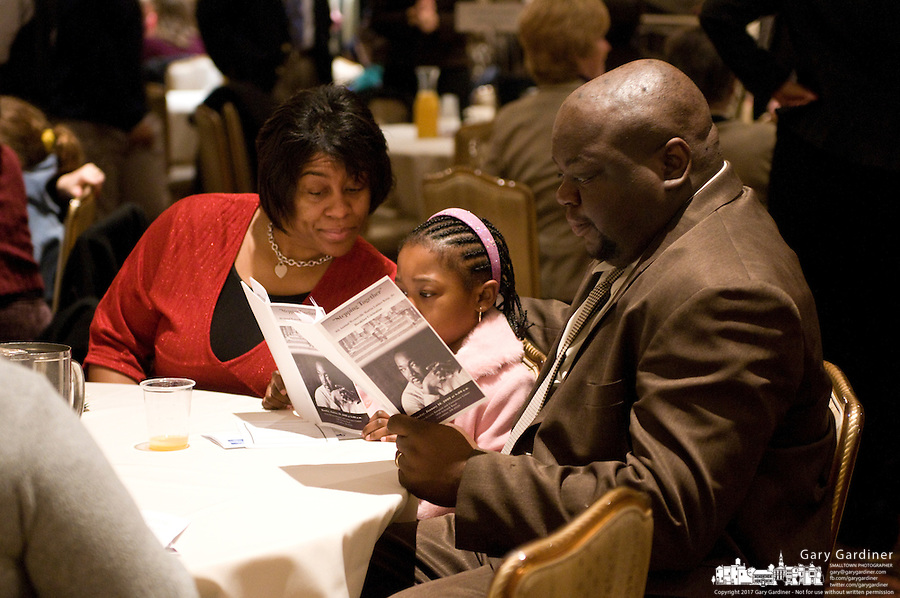 The Stevenson family reads the program before the beginning of the 2009 Westerville, Ohio, MLK Day Celebration. From left are Waldean, Alice and William Stevenson. Photo Copyright Gary Gardiner. Not be used without written permission detailing exact usage.