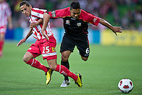 MELBOURNE, AUSTRALIA - NOVEMBER 19: Adrian Zahra of the Heart and Cassio of Adelaide in action during the round 15 A-League match between the Melbourne Heart and Adelaide United at AAMI Park on November 19, 2010 in Melbourne, Australia (Photo by Sydney Low / Asterisk Images)