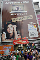 A Lenovo advertising billboard outside the Tianhe computer centre in Guangzhou, China. The financial crisis won't have too much impact on Chinese consuming market. According to a survey by Nielsen of 50 countries and regions, only 35 percent of Chinese people believed the domestic economy was in a contraction. The figure was the lowest among the 50 world markets..