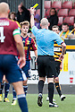 Livy's Ross Docherty receives his second yellow card and is sent off by Referee Bobby Madden.