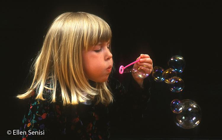 MR / Schenectady, NY. Girl (age 4) blows bubbles. MR: Kol1. ID: AJ-LC. © Ellen B. Senisi