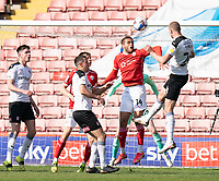 24th April 2021, Oakwell Stadium, Barnsley, Yorkshire, England; English Football League Championship Football, Barnsley FC versus Rotherham United; Michael Smith of Rotherham heads under pressure from Carlton Morris of Barnsley but his header is saved by Bradley Collins of Barnsley