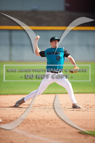 Alex Binelas (12) of Oak Creek HS High School in Oak Creek, Wisconsin during the Under Armour All-American Pre-Season Tournament presented by Baseball Factory on January 14, 2017 at Sloan Park in Mesa, Arizona.  (Mike Janes/Mike Janes Photography)