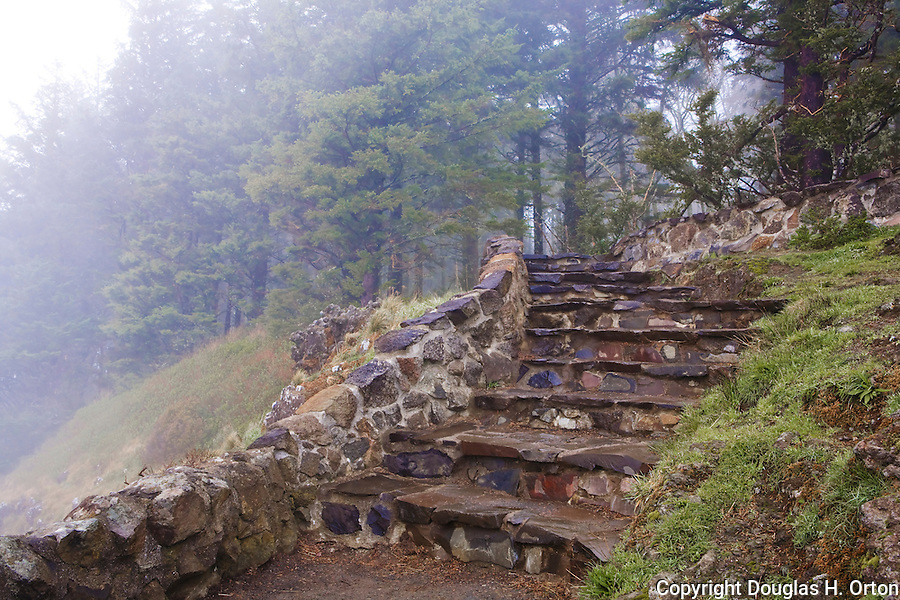 Viewpoint at top of Cape Perpetua, Oregon, shrouded in fog has beautiful CCC stone work.