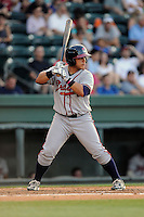 Designated hitter Bryan De La Rosa (26) of the Rome Braves bats in a game against the Greenville Drive on Monday, June 15, 2015, at Fluor Field at the West End in Greenville, South Carolina. Greenville won, 9-3. (Tom Priddy/Four Seam Images)