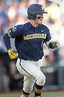 Michigan Wolverines catcher Joe Donovan (0) runs to first base against the Vanderbilt Commodores during Game 3 of the NCAA College World Series Finals on June 26, 2019 at TD Ameritrade Park in Omaha, Nebraska. Vanderbilt defeated Michigan 8-2 to win the National Championship. (Andrew Woolley/Four Seam Images)