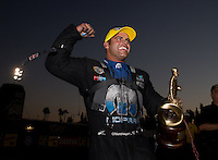Nov 10, 2013; Pomona, CA, USA; NHRA funny car driver Matt Hagan celebrates after winning the Auto Club Finals at Auto Club Raceway at Pomona. Mandatory Credit: Mark J. Rebilas-
