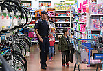 Shoppers browse at the 10th annual Holiday with a Hero event at Walmart in Carson City, Nev., on Wednesday, Dec. 17, 2014. The event pairs 200 of Carson City's K-5th grade homeless students with a local heroes for Christmas shopping. <br /> Photo by Cathleen Allison