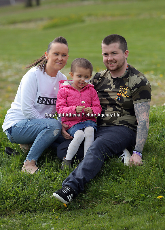 """COPY BY TOM BEDFORD<br /> Pictured: Mia Chambers (C) with dad Josh (R) mum Kirsty (L) <br /> Re: One of Britain's poorest towns is raising £100,000 to send a little girl to America because the lifesaving drugs she needs are not available on the NHS.<br /> Brave Mia Chambers, five, is in remission after having an ovary and kidney removed due to neuroblastoma, a rare and aggressive type of cancer.<br /> Doctors have told her parents Josh and Kirsty there is a 50 per cent chance of the cancer returning without the specialist drugs.<br /> Josh, 28, said: """"That's not a chance we are prepared to take - the odds are too high.<br /> """"We researched it on the internet and found children in the US are beating this terrible illness.<br /> """"Doctors there are willing to treat her but it will cost more money than we have.""""<br /> The couple's plight has touched the hearts of people in their home town of Merthyr Tydfil, South Wales, and money has begun pouring in.         <br /> Mia had chemotherapy on the Rainbow ward at the Noah's Ark Children's Hospital for Wales where nurses nicknamed her the Rainbow Warrior because of her fighting spirit."""
