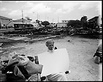 At 62nd Street and 17th Avenue in Miami lies Umoja Village. It is on the west side of I-95. Max Rameau a community leader built the shanty town in response to the county housing scandal where developers were stealing millions of dollars earmarked for affordable housing. Over 60 people are living in the village made up of pallets and old sofa's. .    Early in the morning of Thursday April 26th a candle that was left unattended started a fire that burnt the Umoja Village to the ground. The next day activists squared off against police trying to rebuild their village. About a dozen people were arrested trying to erect tents. Among those arrested was Max Rameau the leader of the group. Among the residents is John Cata. He chained himself to some furniture. The land was eventually cleared after some difficulties were protesters jumped on the bulldozers and had to be arrested. .    Miami has an affordable housing crisis and the Umoja Village fire has brought this to many people's attention.
