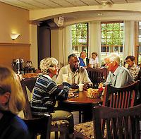 Seniors enjoying breakfast at inn or assisted living center.