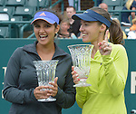 Martina Hingis (SUI) with partner Sania Mirza (IND), win the doubles finals