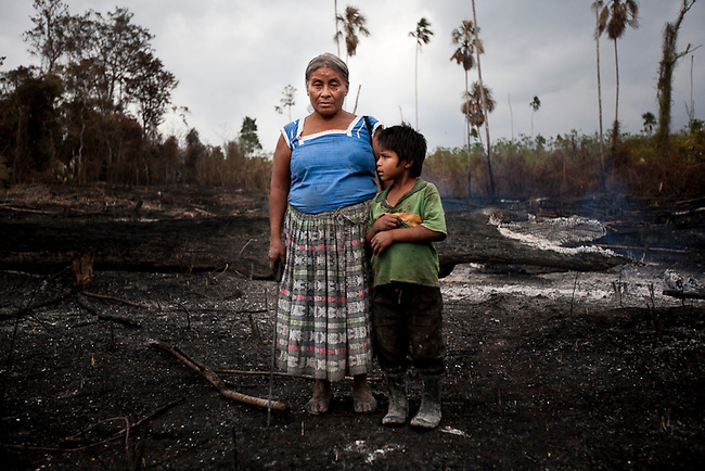 A single mother and her child at their maize field inside the Mayan Biosphere