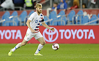 TORONTO, ON - OCTOBER 15: Tim Ream #13 of the United States looks for an open man downfield during a game between Canada and USMNT at BMO Field on October 15, 2019 in Toronto, Canada.