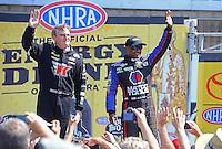 Jun. 3, 2012; Englishtown, NJ, USA: NHRA top fuel dragster driver Antron Brown (right) and Doug Kalitta during the Supernationals at Raceway Park. Mandatory Credit: Mark J. Rebilas-