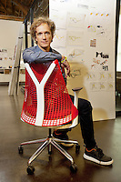 USA. California state. San Francisco. Potero Hill district. Ives Béhar seats in Fuseproject offices on the Herman Miller Sayl chair which he has designed. Yves Béhar (born 1967) is a Swiss designer, renowned entrepreneur, and sustainability advocate. He is the founder and principal designer of Fuseproject, an award-winning industrial design and brand development firm. Béhar is also Chief Creative Officer of the wearable technology company Jawbone, and Co-founder and Chief Creative Officer of August, a Smart Lock maker. Béhar's design work emphasizes the integration of commercial products with sustainability and social good. His clients have included Herman Miller, PUMA, MINI, See Better to Learn Better, General Electric, Swarovski, Samsung, Jimmyjane, and Prada. He is the chief industrial designer of One Laptop per Child (OLPC's) XO laptop, signing on with the project in 2005 and has been with the team since March 2006. This collaboration has led to two additional laptop prototypes, the OLPC XOXO and OLPC XO-3. In 2012 SodaStream International teamed with Béhar to introduce Source, a new home soda machine designed with a special emphasis on sustainability. 15.12.2014 © 2014 Didier Ruef