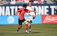 CHICAGO, IL - OCTOBER 06: Becky Sauerbrunn #4 of the United States and , SON HWA-YEON #22 of the Korea Republic battle for a ball during a game between the USA and Korea Republic at Soldier Field, on October 06, 2019 in Chicago, IL.