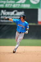 Akron RubberDucks Connor Marabell (16) points to his teammates in the bullpen while rounding the bases after hitting a home run during an Eastern League game against the Bowie Baysox on May 30, 2019 at Prince George's Stadium in Bowie, Maryland.  Akron defeated Bowie 9-5.  (Mike Janes/Four Seam Images)