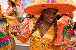 A woman dances during the street parade for the ZomerCarnaval (Summer Carnival) in Rotterdam, the Netherlands. The street parade is the colorful high point of the Rotterdam carnival. It is a tropical themed parade with over 2000 participants and travels 6km through the center of Rotterdam.