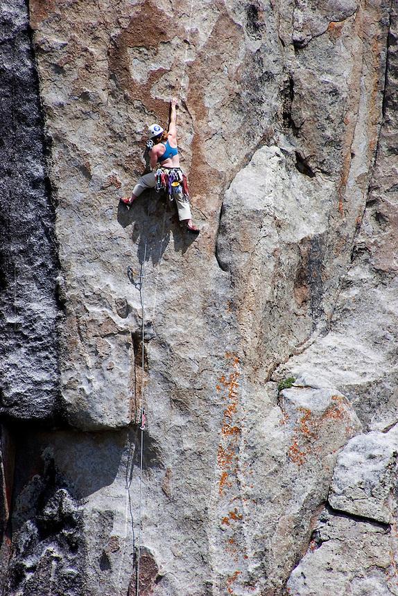 A climber scaling one of many rock formations at City of Rocks, Idaho.