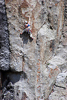 A climber scaling one of many rock formations at City of Rocks, Idaho.