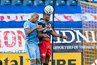FOXBOROUGH, MA - SEPTEMBER 19: Brandon Bye #15 of New England Revolution heads the ball during a game between New York City FC and New England Revolution at Gillette on September 19, 2020 in Foxborough, Massachusetts.