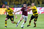 AC Milan Midfielder Giacomo Bonaventura (C) fights for the ball with Borussia Dortmund Midfielder Sebastian Rode (R) during the International Champions Cup 2017 match between AC Milan vs Borussia Dortmund at University Town Sports Centre Stadium on July 18, 2017 in Guangzhou, China. Photo by Marcio Rodrigo Machado / Power Sport Images
