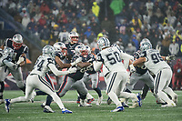 FOXBOROUGH, MA - NOVEMBER 24: New England offensive line hold off the Dallas defenders as New England Patriots Quarterback Tom Brady #12 looks for an opening for a pass during a game between Dallas Cowboys and New England Patriots at Gillettes on November 24, 2019 in Foxborough, Massachusetts.
