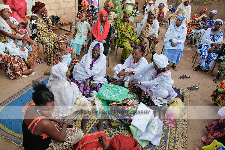 In Burkina Faso, West Africa, Muslim families celebrate the birth of a child on the 7th day after birth.  Women throughout the city - friends and family - congregate at the mother's house in Ouagadougou on the afternoon of the baptism, bearing gifts of cloth, clothing, soap, and cash.  Yet, the majority of these gifts are not destined for the new mother or baby!  The sister of the new mother has been set in charge of dividing up the gifts and giving them to both the new mother and to guests.