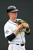 Catcher Dan Rizzie (7) of the Columbia Fireflies warms up before a game against the Augusta GreenJackets on Saturday, April 7, 2018, at Spirit Communications Park in Columbia, South Carolina. Augusta won, 6-2. (Tom Priddy/Four Seam Images)