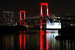 """The Rainbow Bridge is lit up in red, after the Tokyo Metropolitan Government has issued a """"Tokyo alert"""" due to an increase in coronavirus cases in Tokyo, Japan on June 2, 2020. (Photo by Pasya/AFLO)"""