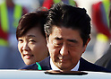 Prime Minister Abe and wife Akie return to Japan from the US