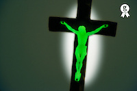 Phosphorescent crucifix in the dark (Licence this image exclusively with Getty: http://www.gettyimages.com/detail/96354151 )