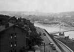 Pittsburgh PA:  View looking south towards the South Side and Monongahela River from the bluff at Duquesne University. View of the 10th Street bridge under construction and J&L Steel plant.