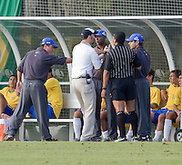 Officials speaking with Brazilian coaches after Carvalho (not pictured) receives a red card. 2007 Nike Friendlies, which are taking place from Dec. 6-9 at IMG Academies in Bradenton, Fla.