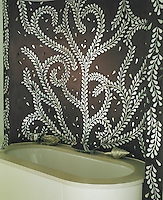 In this bathroom traditional Indian mother-of-pearl inlays are brought to mind by the stunning mural behind the bath