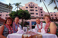 Tourists enjoying the luau at the Royal Hawaiian Hotel in Waikiki