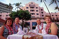 Tourists enjoying the luau at the Royal Hawaiian Hotel in Waikiki