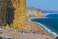 BNPS.co.uk (01202 558833)<br /> Pic: Graham Hunt/BNPS<br /> Date: 7th September 2021.<br /> <br /> Sunbathers flock to the beach to enjoy the scorching hot sunshine at the seaside resort of West Bay in Dorset during a mini heatwave.
