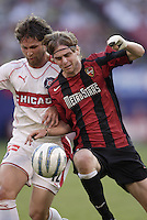 The Fire's Logan Pause battles Eddie Gaven of the MetroStars for a ball played into space during first half action between the MetroStars and the Chicago Fire at Giant's Stadium, East Rutherford, NJ, on May 31, 2005.