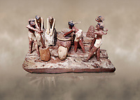 Ancient Egyptian wooden model of bread making, Middle Kingdom, (1939-1875 BC),  Egyptian Museum, Turin. <br /> <br /> Wooden tomb models were an Egyptian funerary custom throughout the Middle Kingdom in which wooden figurines and sets were constructed to be placed in the tombs of Egyptian royalty. These wooden models represented the work of servants, farmers, other skilled craftsman, armies, and religious rituals