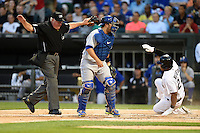 Toronto Blue Jays catcher Dioner Navarro (30) looks for the ball after  attempting to tag Dayan Viciedo (24) sliding home safely as umpire Tim Welke signals safe during a game against the Chicago White Sox on August 15, 2014 at U.S. Cellular Field in Chicago, Illinois.  Chicago defeated Toronto 11-5.  (Mike Janes/Four Seam Images)