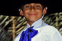 Portrait of a smiling Mexican boy with a big black hat and blue tie at a folk dance foto, reise, photograph, image, images, photo,<br />