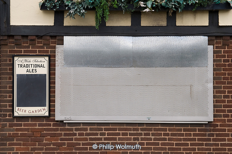 Steel shutters on a closed pub in Walsall, West Midlands