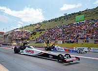 Jul 21, 2019; Morrison, CO, USA; NHRA top fuel driver Steve Torrence (near) races alongside Brittany Force during the Mile High Nationals at Bandimere Speedway. Mandatory Credit: Mark J. Rebilas-USA TODAY Sports